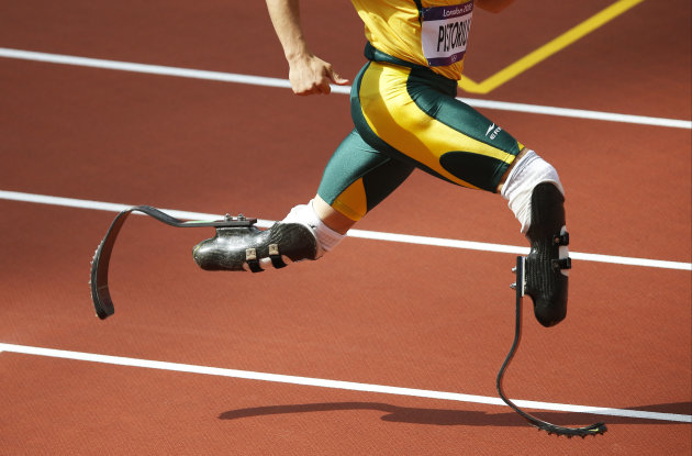 South Africa's Oscar Pistorius competes in a men's 400-meter heat during the athletics in the Olympic Stadium at the 2012 Summer Olympics, London, Saturday, Aug. 4, 2012. (AP Photo/Daniel Ochoa De Olza)
