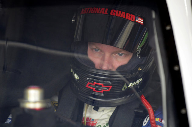 Dale Earnhardt Jr. sits in his car during practice for Sunday's NASCAR Sprint Cup Series Coca-Cola 600 auto race in Concord, N.C., Thursday, May 24, 2012. (AP Photo/Mike McCarn)
