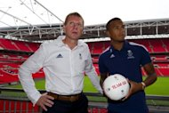Britain's Olympic football coach Stuart Pearce (L) poses for a photo with Chelsea player Ryan Bertrand, on July 2, after a press conference at Wembley Stadium in London, to announce the squad for the 2012 Olympic Games