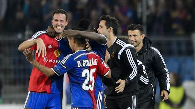 Basel's forward Marco Streller (L) is congratulated by teammates after scoring a goal during their UEFA Champions League match against FC Liverpool, in Basel, on October 1, 2014