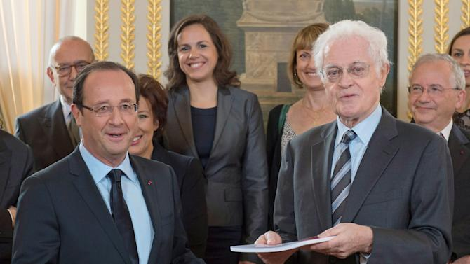 "French President Francois Hollande, left, is handed a report entitled, ""For a democratic renewal"" from former French prime minister Lionel Jospin, right, at the Elysee Palace in Paris, Friday, Nov. 9, 2012. (AP Photo/Bertrand Langlois, Pool)"