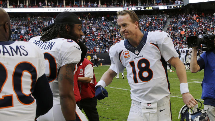 Denver Broncos' Peyton Manning (18) celebrates with teammates after he threw a touchdown pass against the Houston Texans during the third quarter of an NFL football game on Sunday, Dec. 22, 2013, in Houston. The touchdown pass was his 51st of the season. (AP Photo/David J. Phillip)