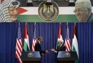 U.S. President Barack Obama and Palestinian President Mahmoud Abbas shake hands at a news conference at the Muqata Presidential Compound in the West Bank City of Ramallah March 21, 2013. REUTERS/Larry Downing