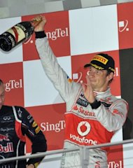 "Jenson Button on the podium at the Singapore Grand Prix on September 23. ""Having (the F1) in Austin is great because it's a very young city and that's what we need, to get young fans into the sport,"" Button said. ""That's the way to grow the sport in the States and hopefully we will do that."""