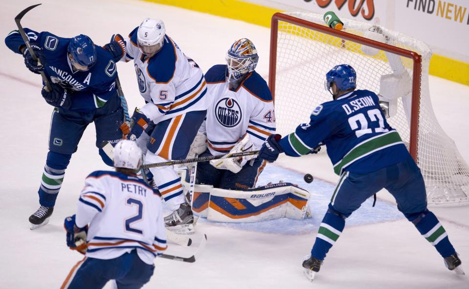 Canucks pound Oilers for 6-2 victory