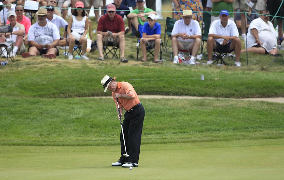 Tom Kite putts on the third hole during the third round at the U.S. Senior Open golf tournament at the Indianwood Golf and Country Club in Lake Orion, Mich., Saturday, July 14, 2012. (AP Photo/Carlos Osorio)