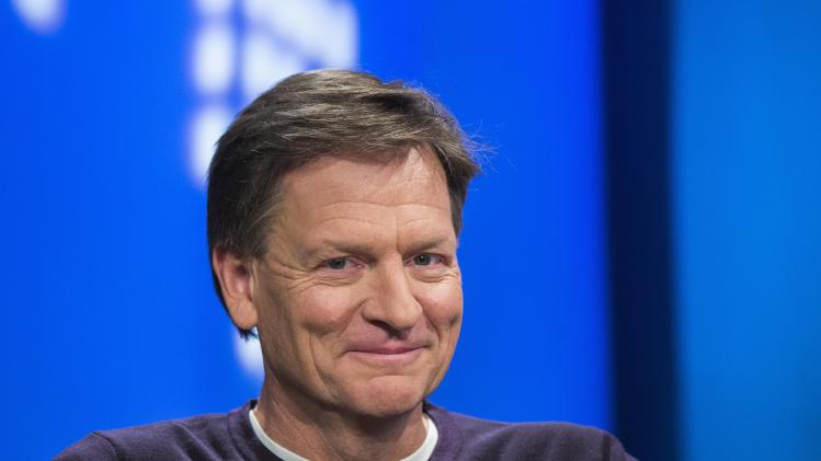 "File photo of Author Michael Lewis smiling during an interview at Reuters regarding his book about high-frequency trading (HFT) named ""Flash Boys: A Wall Street Revolt,"" in New York"