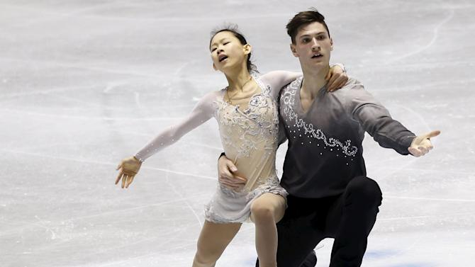 Koga and Boudreau Audet of Japan compete during the pairs free skating program at the ISU World Team Trophy in Figure Skating in Tokyo