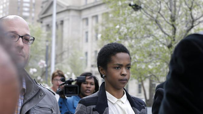 """Singer Lauryn Hill walks from federal court in Newark, N.J., Monday, April 22, 2013, after a judge postponed her  tax evasion sentencing and scolded the eight-time Grammy winner for reneging on a promise to make restitution. Hill pleaded guilty last year to not paying federal taxes on $1.8 million earned from 2005 to 2007. At that time, her attorney said she would pay more than $500,000 by the time of her sentencing. It was revealed Monday in court that Hill has paid $50,000. The South Orange resident got her start with The Fugees and began her solo career in 1998 with the acclaimed album """"The Miseducation of Lauryn Hill."""" (AP Photo/Mel Evans)"""