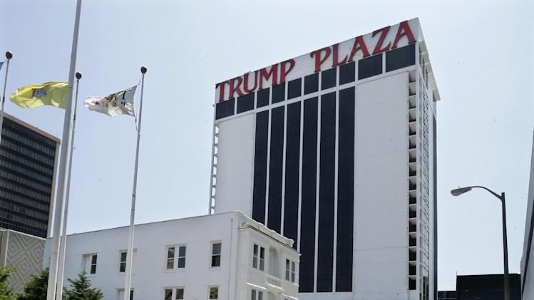Trump Plaza Hotel and Casino towers over Vera Coking's three story rooming house Wednesday, July 23, 2014, in Atlantic City, N.J. The decrepit boarding home owned by the Atlantic City woman who has been turning down multi-million dollar offers for the building in the shadow of Trump Plaza since the 80's is now up for auction. With a reserve price of only $199,000, the fate of the house has gone down along with the city's casino industry. On July 31, the property, at 127 South Columbia Place, will go up for auction. As recently as eight years ago, Donald Trump was willing to pay at least 10 times that amount so he could expand Trump Plaza Hotel and Casino. (AP Photo/Mel Evans)