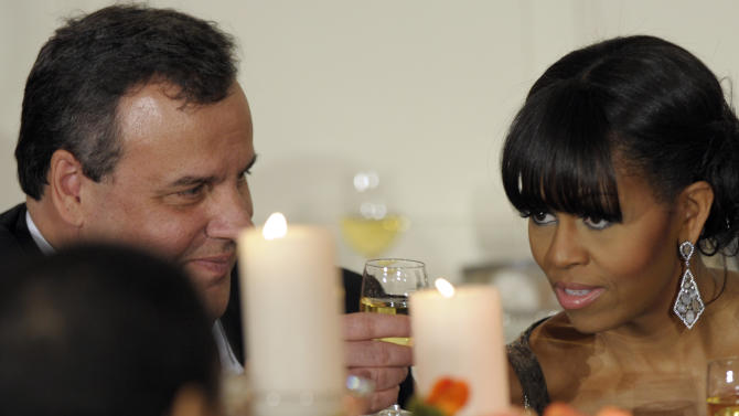 New Jersey Gov. Chris Christie shares a toast with first lady Michelle Obama as President Barack Obama welcomed the governors of the National Governors Association to the 2013 Governors' Dinner at the White House in Washington, Sunday, Feb. 24, 2013. (AP Photo/Susan Walsh)