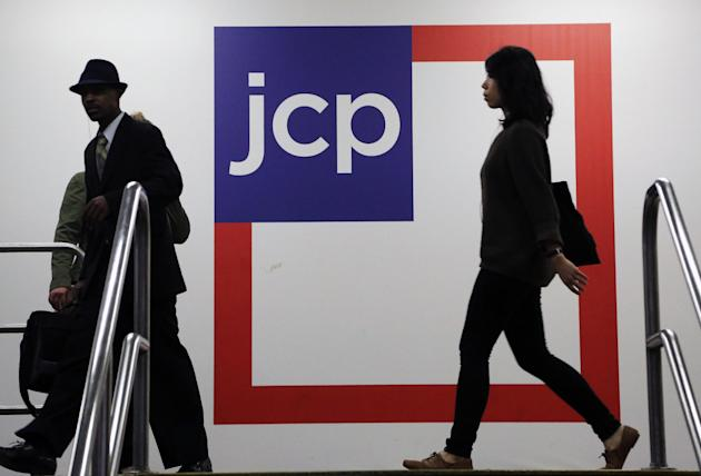 In this Tuesday, April 9, 2013, photo, Customers shop at a J.C. Penney store, in New York. The government reports how much consumers spent and earned in April on Friday, May 31, 2013. (AP Photo/Mark Lennihan)