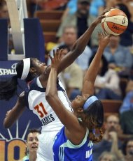 Connecticut Sun's Tina Charles, left, blocks a shot by New York Liberty's Kara Braxton in the first half of a WNBA basketball game in Uncasville, Conn., Friday, June 15, 2012. (AP Photo/Jessica Hill)