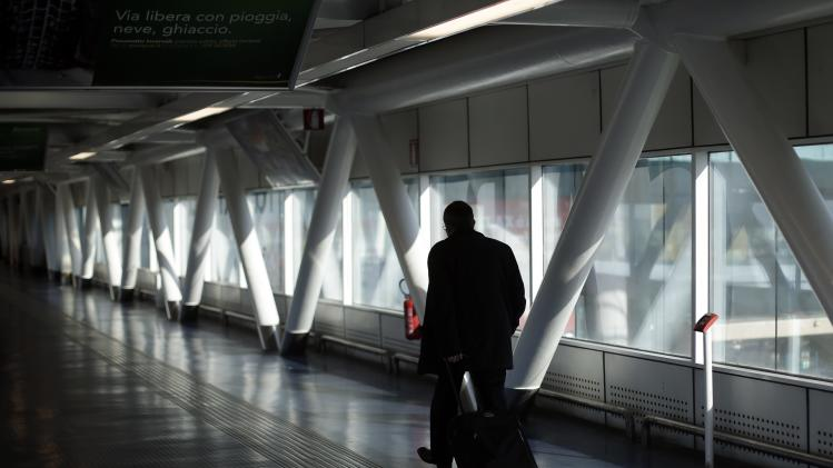 A passenger walks at Fiumicino airport in Rome