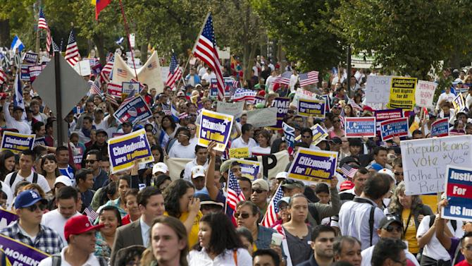 Demonstrators march toward Capitol Hill during a immigration rally and march in Washington, D.C., Tuesday, Oct. 8, 2013. (Jose Luis Magana/AP)