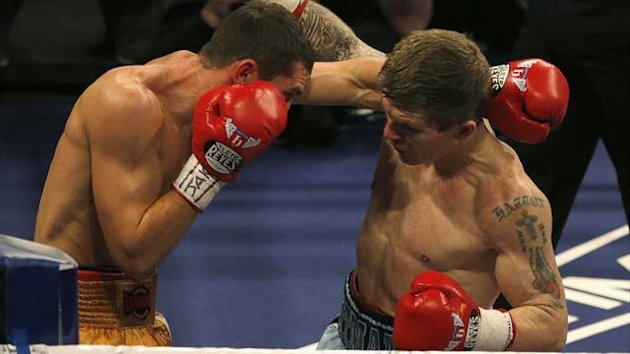 Britain's Ricky Hatton (R) throws a punch at Ukraine's Vyacheslav Senchenko during their boxing match at the Manchester Arena