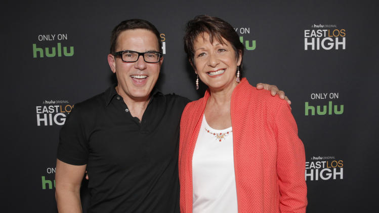 Co-Creator/Director Carlos Portugal and Ivonne Coll attend Hulu's East Lost High Season 2 Premiere at Landmark Theater on Wednesday July, 9 2014, in Los Angeles. (Photo by Todd Williamson/Invision for Hulu/AP Images)