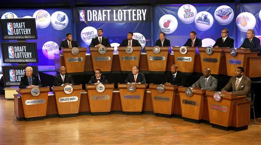 NBA basketball team representatives sit onstage at the start of the NBA draft lottery, Tuesday, May 21, 2013 in New York