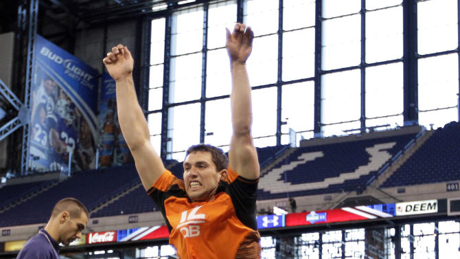 Stanford quarterback Andrew Luck does a broad jump at the NFL football scouting combine in Indianapolis, Sunday, Feb. 26, 2012. (AP Photo/Michael Conroy)