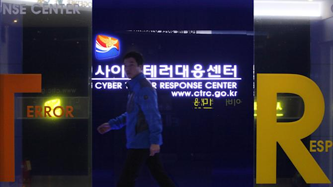 A South Korean police officer from Digital Forensic Investigation walks inside the Cyber Terror Response Center at National Police Agency in Seoul, South Korea, Friday, March 22, 2013. South Korea said Friday it was preparing for the possibility of more cyberattacks as a new team of investigators tried to determine if North Korea was behind a synchronized shutdown of tens of thousands of computers at six South Korean banks and media companies.(AP Photo/Ahn Young-joon)