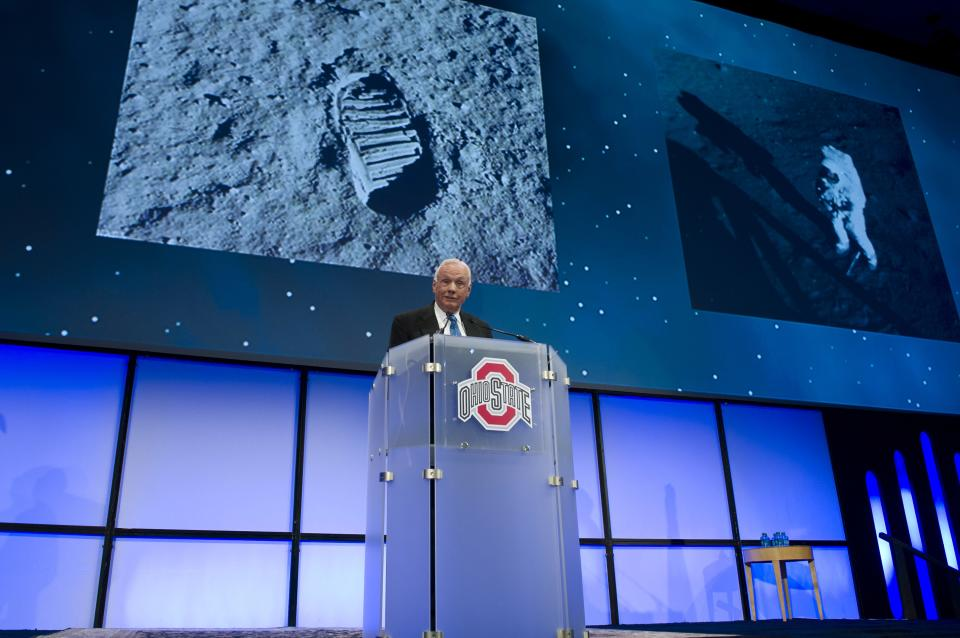 In this Monday, Feb. 20, 2012 photo, Apollo 11 Astronaut Neil Armstrong speaks at a celebration dinner honoring John Glenn's 50th anniversary of his historic flight aboard the Mercury program's Friendship 7 capsule at Ohio State University in Columbus, Ohio. Glenn was the first American to orbit Earth.  (AP Photo/NASA, Bill Ingalls)