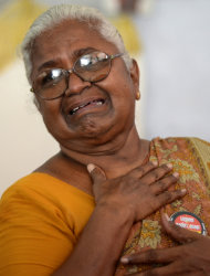 In this Monday Oct.10, 2011, photo, Arputhammal , the mother of Arivu Perarivalan, one of the three convicted in the 1991 assassination of former Indian Prime Minister Rajiv Gandhi, breaks down while talking about her son in Chennai, India. Across most of India the three men on death row in the assassination of Gandhi are reviled as murderous traitors to the nation. But ethnic Tamils in southern India see things very differently. Nearly every major public figure has demanded clemency, sparking a political storm fueled by emotions still raw from the gory 2009 routing of Sri Lanka's Tamil rebels, who ordered the killing. ( AP Photo/ Nathan G.)