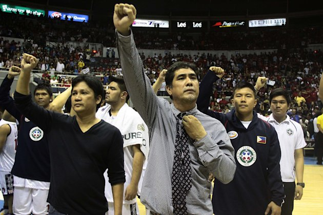 Coach Louie Alas during the singing of Letran's alma mater hymn. (George Calvelo/NPPA Images)