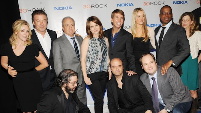 "The cast of '30 Rock' back row, from left, Jane Krakowski, Alec Baldwin, Lorne Michaels, Tina Fey, Jack McBrayer, Katrina Bowden,Keith Powell and front row, from left, Judah Friedlander, Scott Adsit and John Lutz attend the Nokia ""30 Rock"" wrap party on Thursday, Dec. 20, 2012 in New York. (Photo by Scott Gries for Nokia/AP Images)"