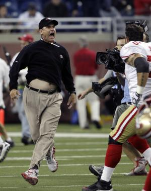 San Francisco 49ers head coach Jim Harbaugh, left, and offensive tackle Alex Boone celebrate their 25-19 win over the Detroit Lions after an NFL football game in Detroit, Sunday, Oct. 16, 2011. (AP Photo/Carlos Osorio)