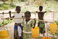 A handout picture released by Oxfam shows children helping in a vegetable garden after school on March 28, 2012 near Banibangou, Niger. Niger has ousted Afghanistan as the worst place in the world to be a mother, largely due to hunger, according to a report by Save the Children