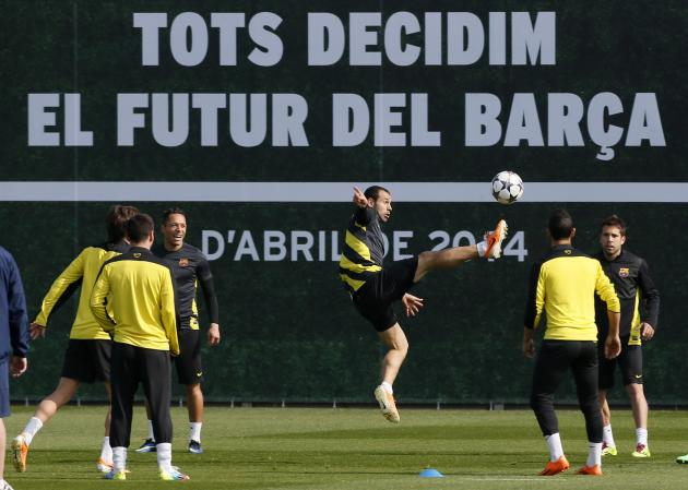 Barcelona's Javier Mascherano controls the ball during a training session at Ciutat Esportiva Joan Gamper in Sant Joan Despi ahead of the Champions League last 16 second leg against Manchester Cit
