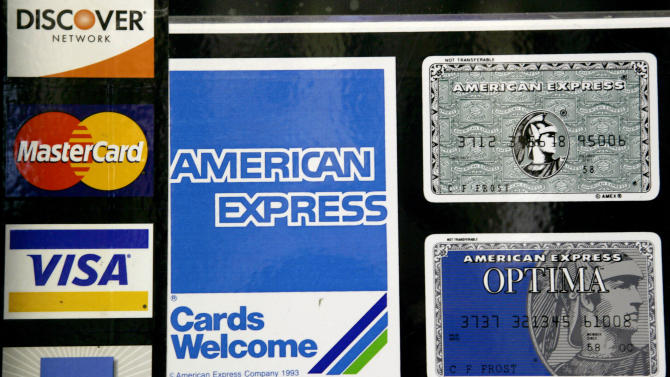 FILE - This Sept. 5, 2007, file photo shows credit card decals on a store window in the Hollywood section of Los Angeles. The Federal Reserve reports on consumer borrowing in May on Tuesday, July 8, 2014. (AP Photo/Nick Ut, File)