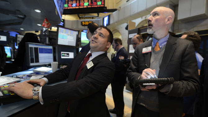In this Wednesday, Feb. 13, 2013, photo, Paul Cosentino, left, of Goldman Sachs and Patrick Armstrong of Prime Executions work on the floor of the New York Stock Exchange, in New York. Goldman Sachs reports quarterly earnings on Tuesday, July 16, 2013. (AP Photo/Henny Ray Abrams)