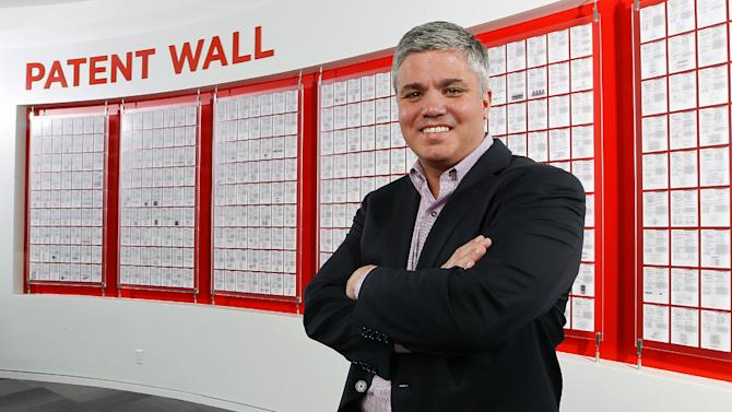 Eric Whitaker, senior vice president and chief legal officer, SanDisk,  poses for a photo in front of SanDisk Patent Wall at the world headquarters in Milpitas, Calif., on Tuesday, April 9, 2013. SanDisk hosted Michelle Lee, the first USPTO Silicon Valley office director, and the Silicon Valley Leadership Group to discuss the importance of having a patent office in an area that is considered the heart of technology innovation.  The innovation captured by intellectual property helped SanDisk become the company it is today with a patent portfolio consistently ranked as one of the top ten in the world. (Tony Avelar / AP Images for SanDisk Corporation)