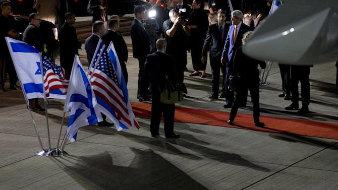 U.S. Secretary of State John Kerry (R) says goodbye as he leaves Israel after meetings in Jerusalem and the West Bank city of Ramallah