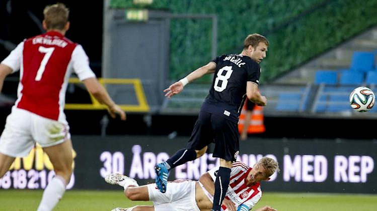 AAB's Thomas Augustinussen, on ground clashes with Domagoj Antolic from Dinamo Zagreb, in their Champions League qualifying round soccer match played in Aalborg, Denmark on Wednesday, July 30, 2014. (AP Photo/ POLFOTO, Rene Schuetze) DENMARK OUT