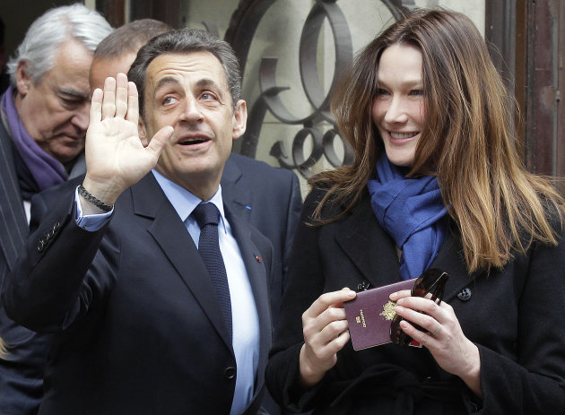 French President and UMP candidate Nicolas Sarkozy and his wife Carla Bruni-Sarkozy leave after casting their votes in the first round of French presidential elections in Paris, France, Sunday, April 