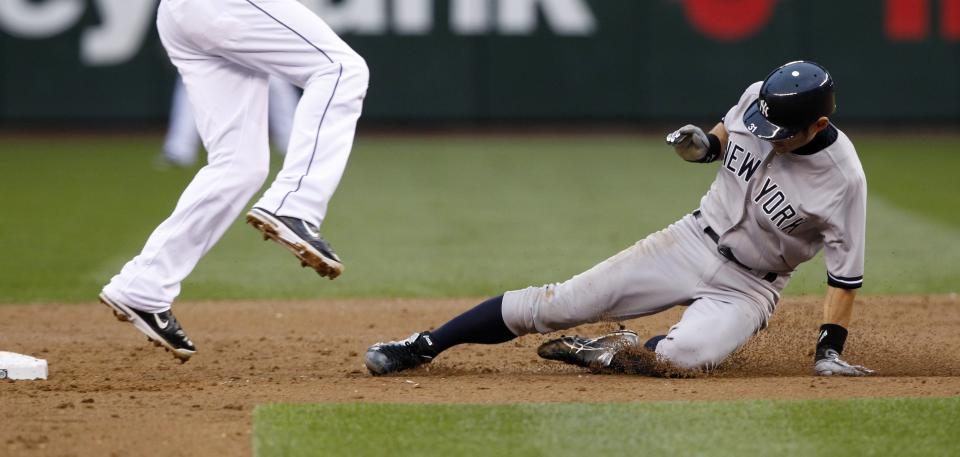 New York Yankees' Ichiro Suzuki steals second base against the Seattle Mariners in the third inning of a baseball game Monday, July 23, 2012, in Seattle. (AP Photo/Elaine Thompson)