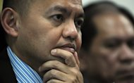 "Chief Philippine government negotiator Marvic Leonen (left) listens during an interview at the Philippine embassy in Kuala Lumpur in 2011. Leonen has announced that the government has made a ""significant"" breakthrough in talks with the Moro Islamic Liberation Front (MILF)"