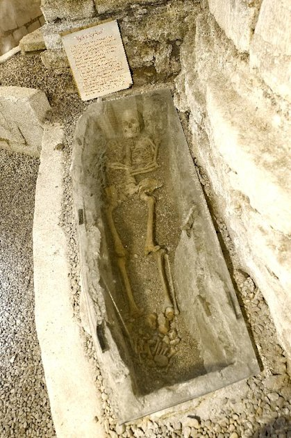 In this image taken in July 2011 shows the tomb and skeleton of what is believed to be an 800-year old Russian man that rests in the cellar. A Swedish real estate agent has an unusual piece of propert