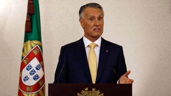 Portugal's President Anibal Cavaco Silva addresses the country from the Belem presidential palace in Lisbon Sunday, July 21 2013. Cavaco Silva had asked the government to reach a consensus with the Socialist Party, the main opposition party, but on Friday Socialist leader Antonio Jose Seguro said his party had left the talks. The president announced that he won't call elections. (AP Photo/Armando Franca)