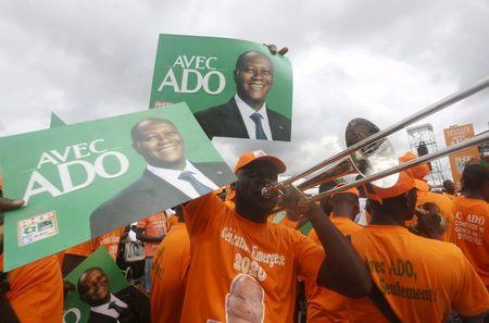 Suporters of Ivory Coast's President Alassane Ouattara and his party, the Rally of the Houphouetists for Democracy and Peace (RHDP), attend a campaign rally at Jean Paul II space in Yamoussoukro