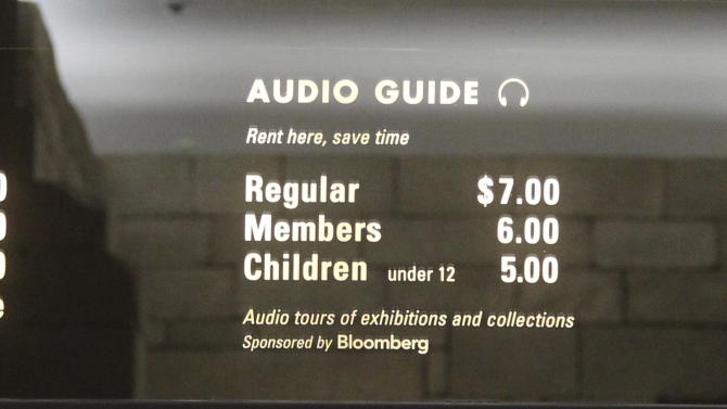"In this Tuesday, March 19, 2013 photo, the board at the Metropolitan Museum of Art in New York displays admission fees, which are recommended but not mandatory. Many visitors to the museum, especially foreign tourists, don't realize that the fees listed on the sign are merely suggestions. Confusion over what's required to enter the Met, which draws more than 6 million visitors a year, is at the heart of a class-action lawsuit this month accusing it of an illegal ""scheme"" to defraud the public into believing the fees are required. (AP Photo/Mary Altaffer)"