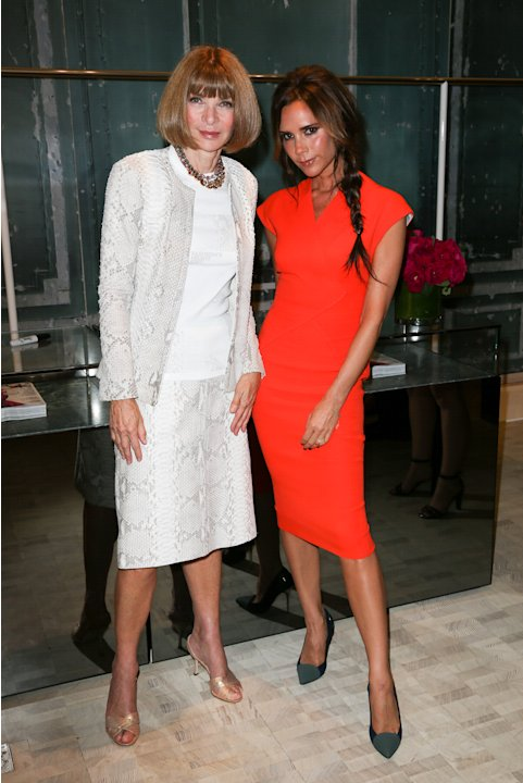 This image released by Starpix shows Vogue editor Anna Wintour, left, and fashion designer Victoria Beckham at a Fashion's Night Out event at Bergdorf Goodman, Thursday, Sept. 6, 2012, kicking off Fas