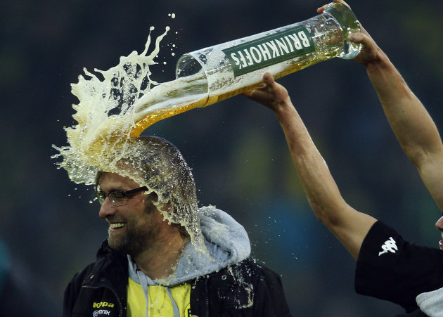 Borussia Dortmund's Piszczek pours beer over coach Klopp after winning German Championship following German first division Bundesliga soccer match against Borussia Moenchengladbach in Dortmund