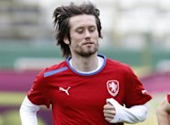 Czech Republic midfielder Tomas Rosicky at a training session in Wroclaw, Poland, on June 20, the day before his side's Euro 2012 quarter-final against Portugal in Warsaw. Playmaker Rosicky will definitely not start the quarter-final against Portugal later on Thursday, team manager Vladimir Smicer told Czech TV