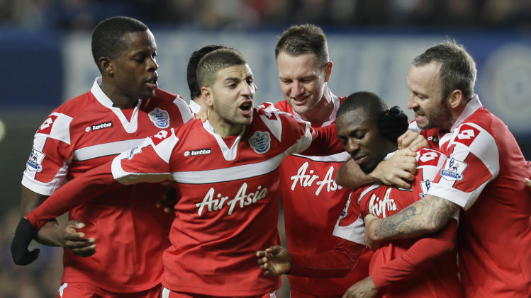 Queens Park Rangers' Shaun Wright-Phillips, second right, celebrates with teammates after scoring a goal against Chelsea during their English Premier League soccer match at Chelsea's Stamford Bridge stadium in London, Wednesday, Jan. 2, 2013.