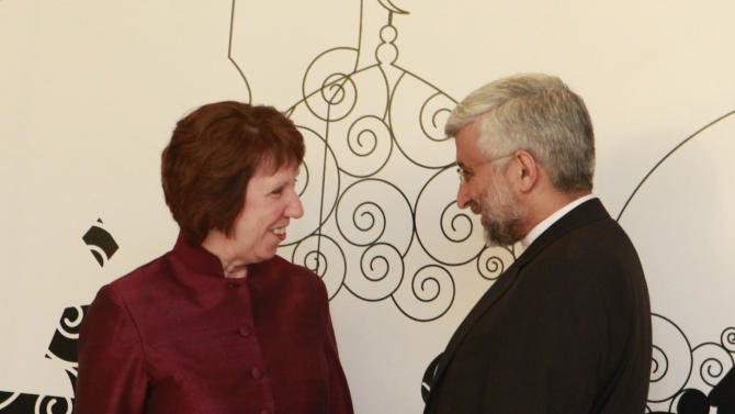 Iran's Chief Nuclear Negotiator Saeed Jalili, right, chats with EU Foreign Policy Chief Catherine Ashton in Baghdad, Iraq, Wednesday, May 23, 2012. Negotiators from the U.S. and five other world powers sat down Wednesday with a team of Iranian diplomats to try to hammer out specific goals in the years-long impasse over Tehran's nuclear program. (AP Photo/Hadi Mizban)