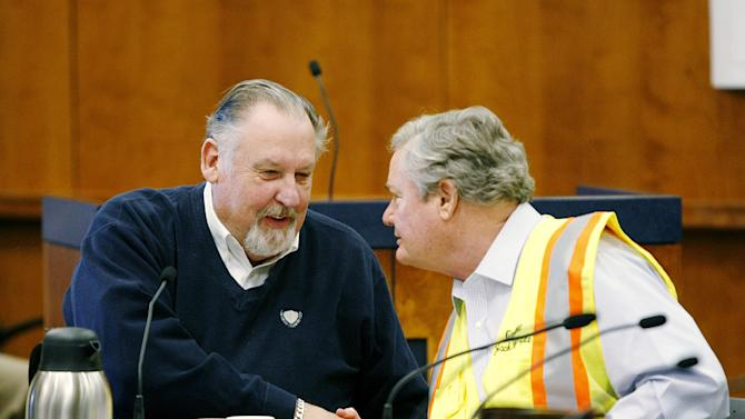 Fargo Mayor Dennis Walaker, left, thanks North Dakota Governor Jack Dalrymple for his involvement in a flood preparation briefing Monday, March 25, 2013, in City Hall. (AP Photo/The Forum, Michael Vosburg)