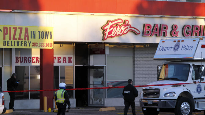Police investigate at Fero's Bar and Grill in Denver on Wednesday, Oct. 17, 2012, where the bodies of a man and four woman were discovered after firefighters extinguished a fire at the bar early Wednesday morning. Police think the blaze was set to cover up their slayings.(AP Photo/Ed Andrieski)